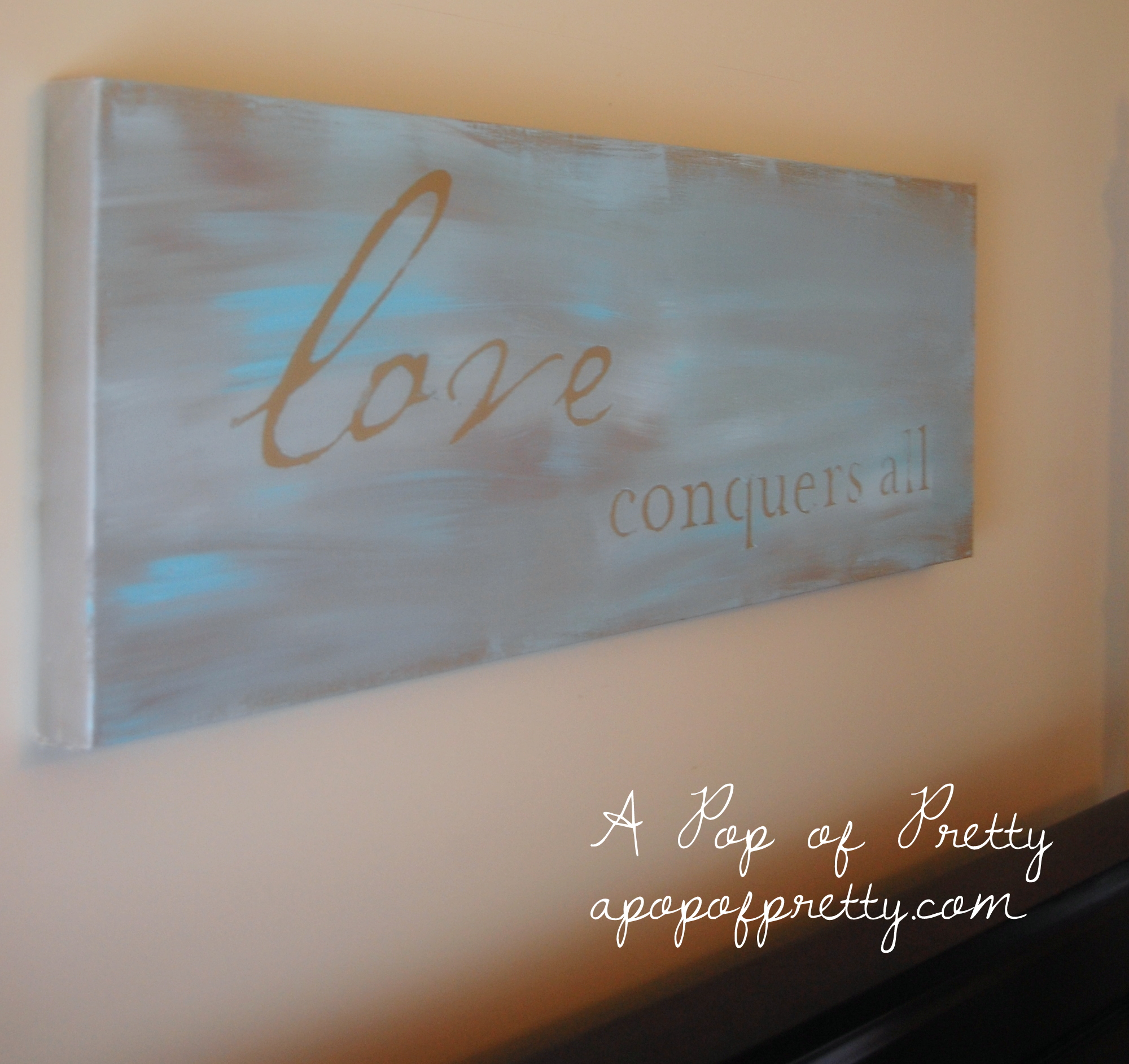 """DIY Wall Art: """"Love Conquers All"""" Painted Canvas"""