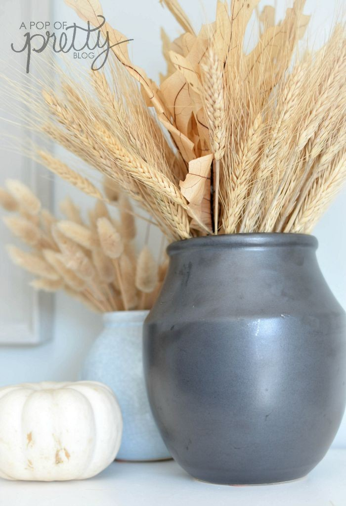 simple Fall mantel with wheat