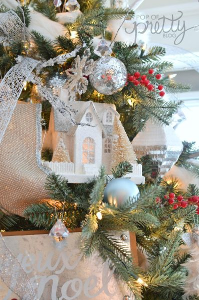 decorating a Christmas tree with houses